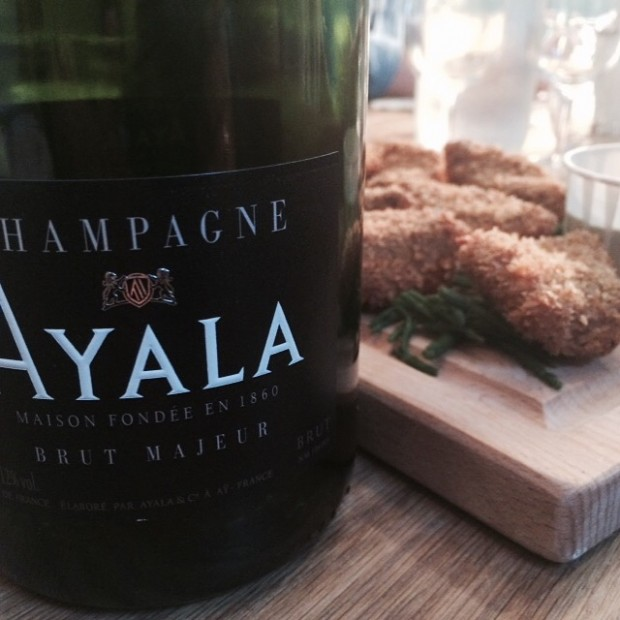 Ayala Champagne Brut Majeur NV with lemon and fennel panko-crumbed sea bass and an oyster and sorrel sauce